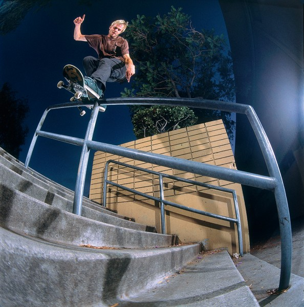 Maximizing every inch of grindability, Madars opts to grind up the face of this rail before grinding down it. Polejam backside Smith grind.