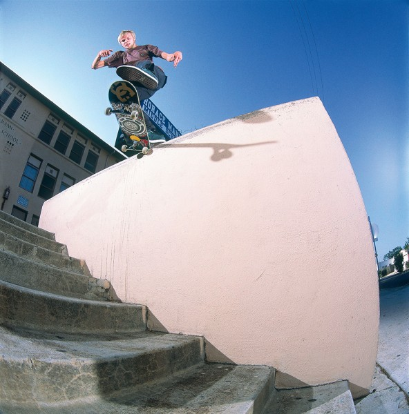 If his teeth survived the nightlife in Ventspils, Latvia, then they sure as hell survived this montrous out ledge. Kickflip backside tailslide.