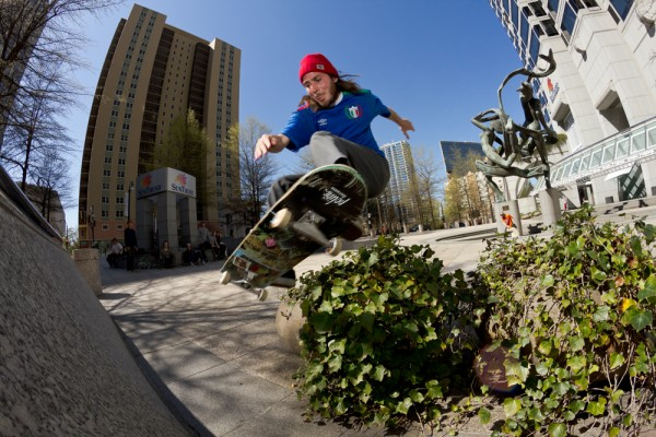 Creasy's got skills on board too! Ollie over the planter to wallride. Photo / MORICO