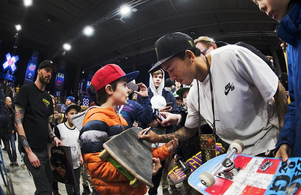 Winner of XGames Skateboarding Oslo, Nyjah Huston signing autographs after comp.