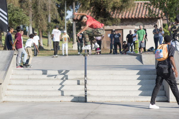 The three stripes were heavily represented by the locals. Kickflip front board with style.