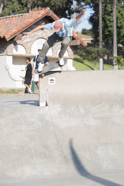 adidas team manager Paul Shier gets a nosebonk 180 in before driving the team down to San Diego for the next demo.