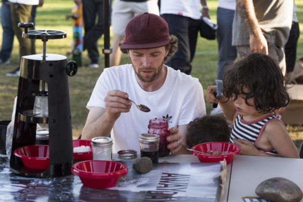 Family time at the demo. Silas and son serve up some homemade shaved ice for the team.