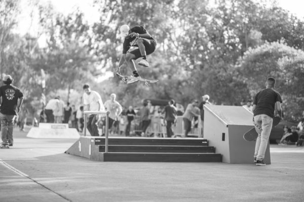 Locked and loaded, the treflip tail grab got the crowd hyped.